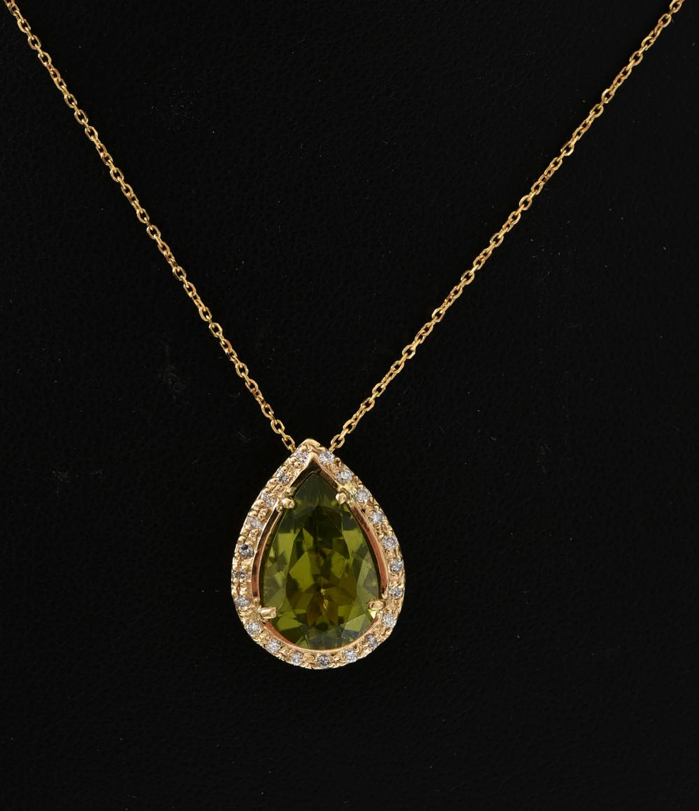 A PERIDOT AND DIAMOND PENDANT IN 18CT GOLD