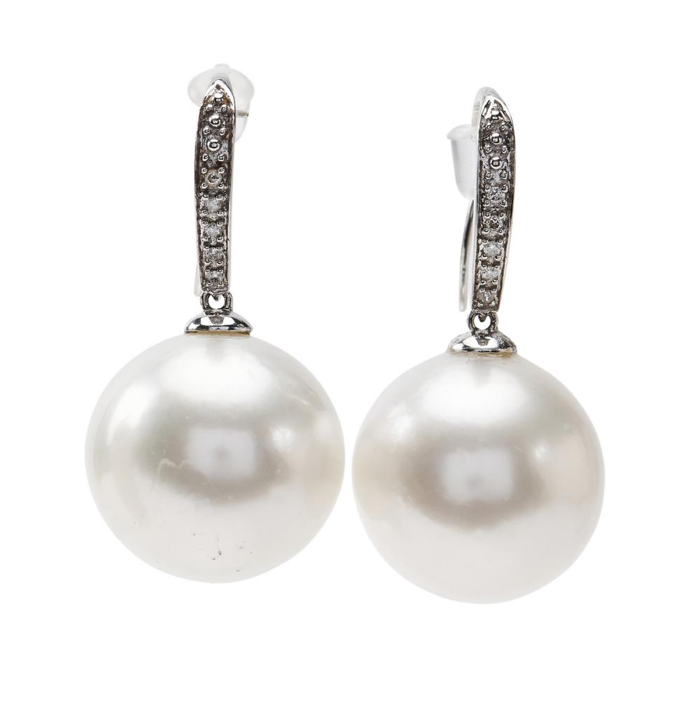 A PAIR OF SOUTH SEA PEARL AND DIAMOND EARRINGS-Each comprising a near round pearl of silver white hues, measuring 15.8mm, to diamond...