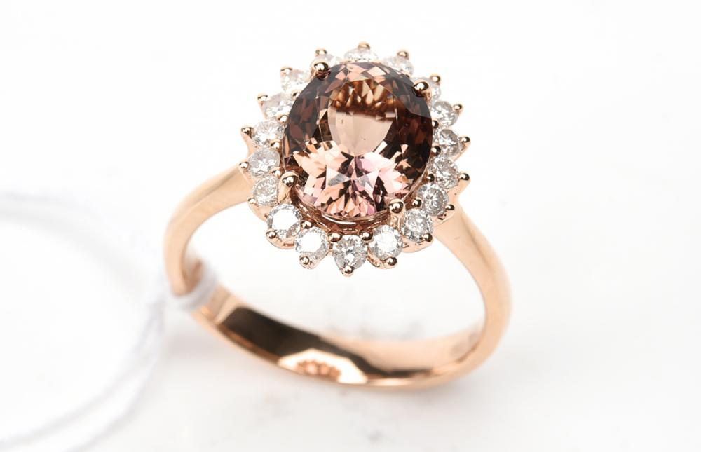 AN UNHEATED TANZANITE AND DIAMOND AND DIAMOND RING IN 18CT ROSE GOLD