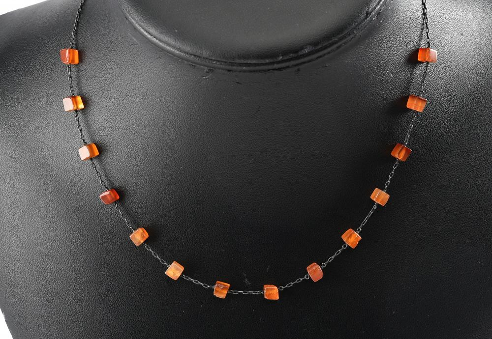 AN AMERICAN AMBER SQUARE BEAD NECKLACE