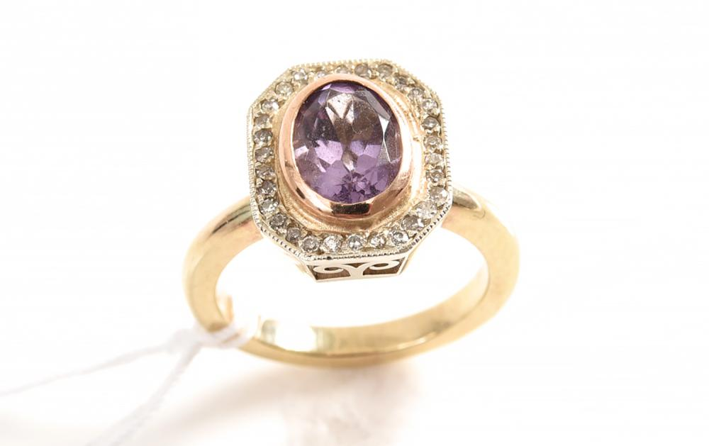 A HANDCRAFTED AMETHYST AND DIAMOND RING IN 18CT GOLD