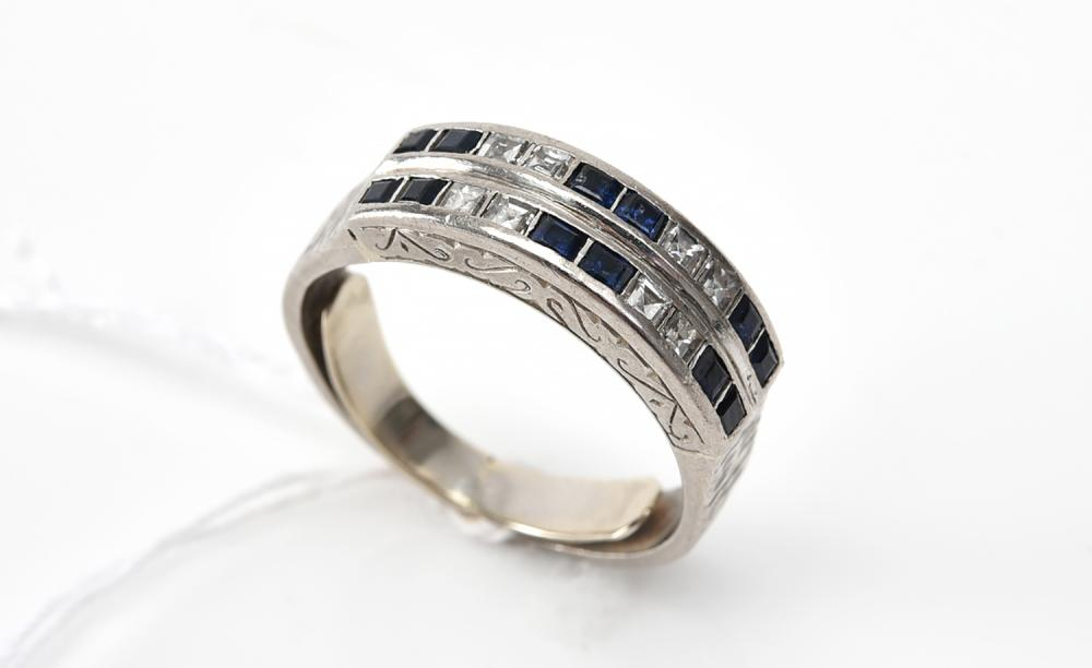 A SAPPHIRE AND DIAMOND ETERNITY RING IN 18CT GOLD
