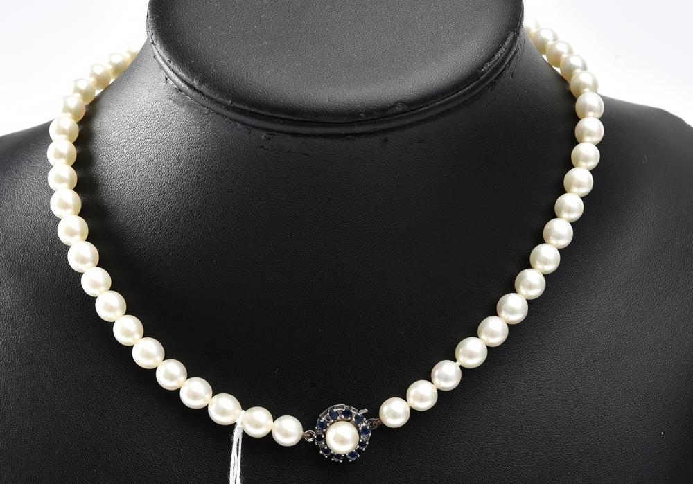 A STRAND OF AKOYA PEARLS TO A SAPPHIRE AND DIAMOND CLASP IN 9CT WHITE GOLD