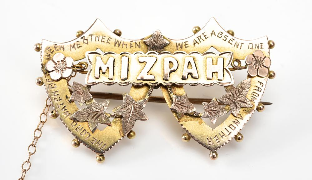 A DOUBLE SHIELD MIZPAH BROOCH IN GOLD