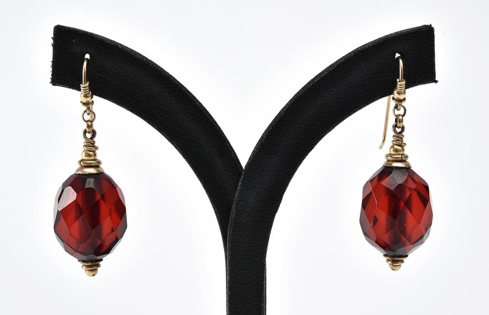 A PAIR OF LARGE FACETED CHERRY AMBER EARRINGS