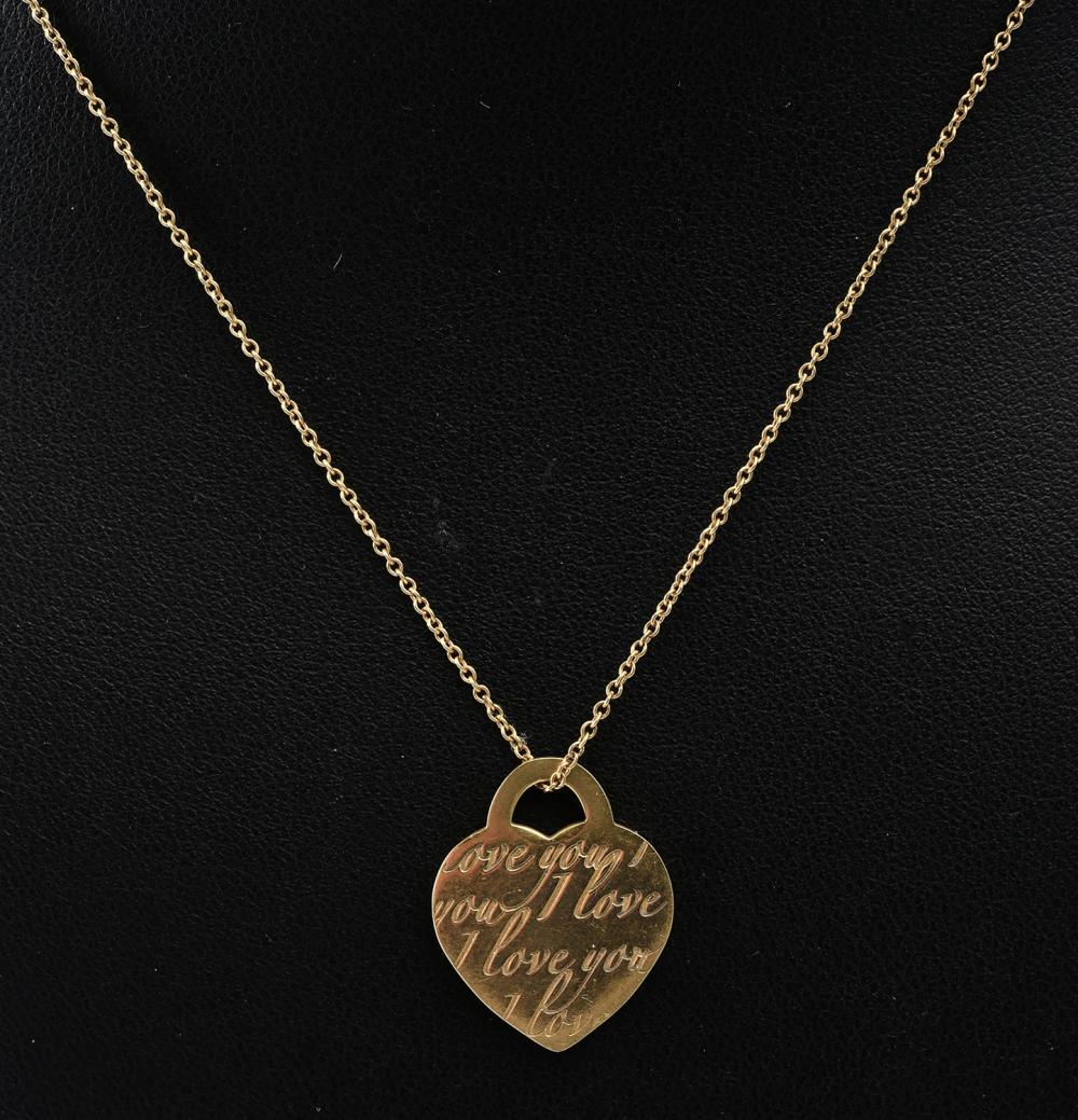"A HEART PENDANT AND CHAIN INSCRIBED ""I LOVE YOU"" BY TIFFANY & CO, IN 18CT GOLD"