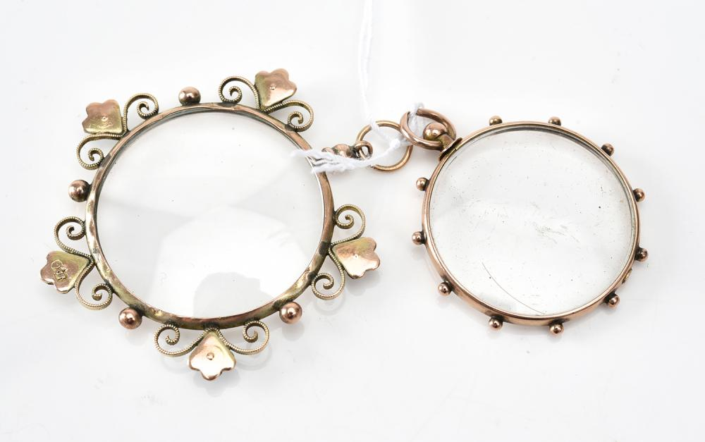 TWO ANTIQUE DOUBLE SIDED LOCKETS IN GOLD, ONE GEM SET