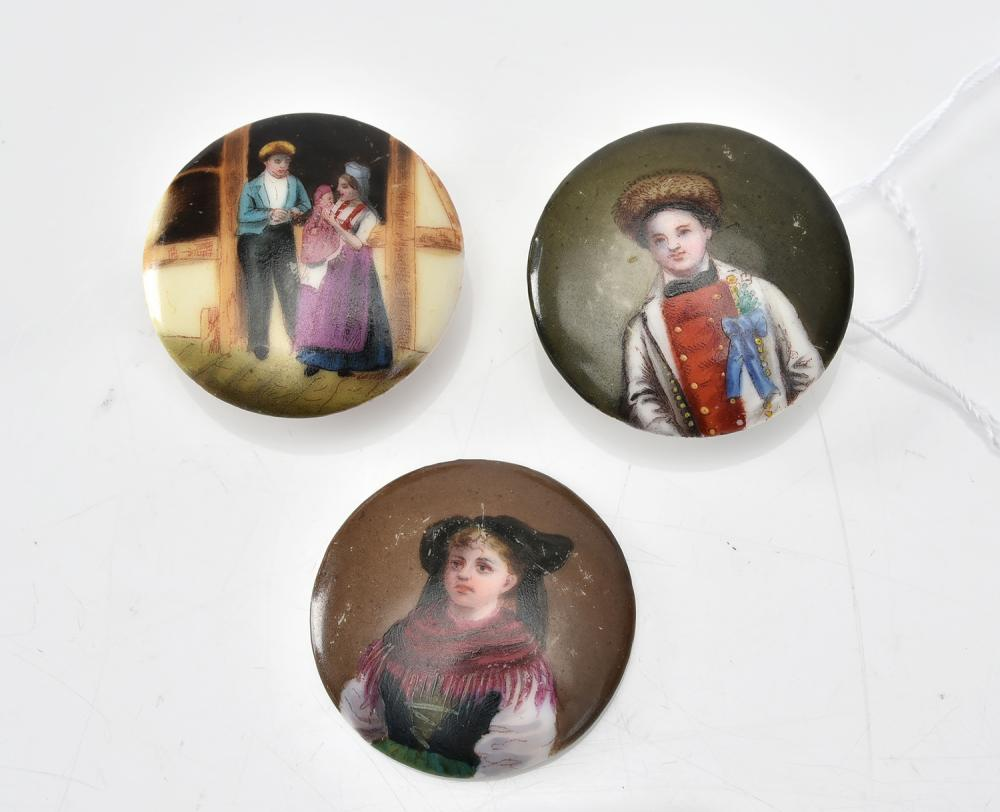 THREE ANTIQUE HAND PAINTED CERAMIC BUTTONS