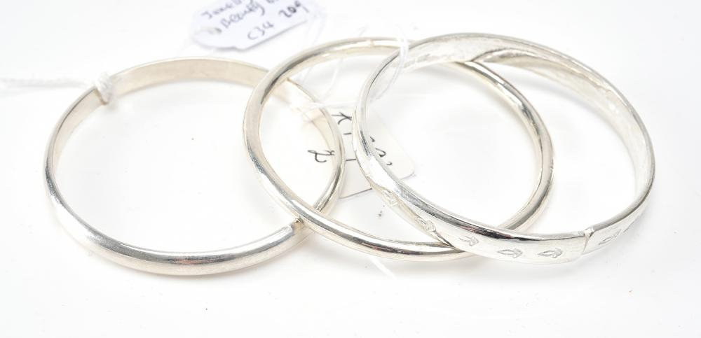 THREE BANGLES, ONE ENGRAVED, ALL IN SILVER