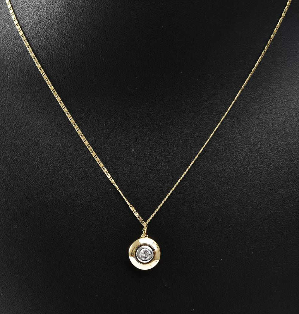 A DIAMOND PENDANT AND CHAIN