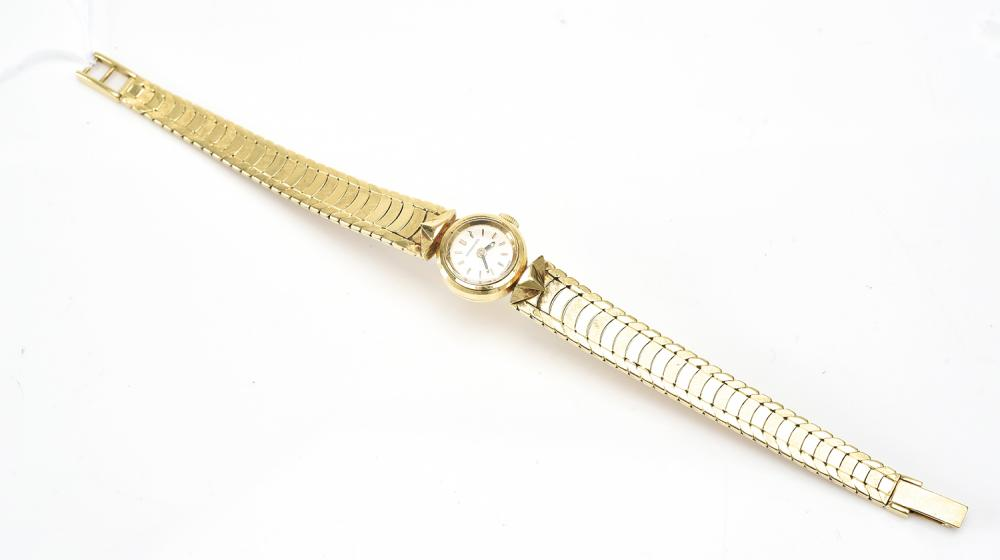 A LADIES LONGINES WRISTWATCH IN 18CT GOLD
