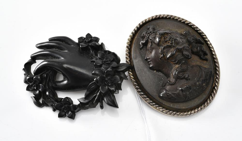 A VICTORIAN MOURNING BROOCH WITH A CARVED CAMEO BROOCH