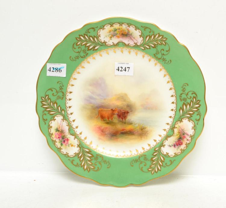 A 1922 ROYAL WORCESTER HIGHLAND CATTLE WITH FLORAL BORDER PLATE BY HARRY STINTON, SIGNED, 23 CM DIAMETER (MINOR FAULTS)