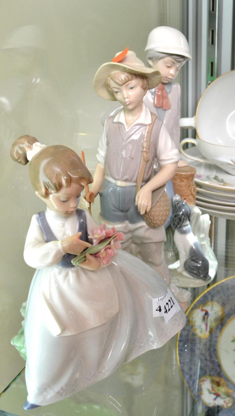 TWO NAO FIGURES AND A LLADRO FIGURE INCLUDING GIRL WITH FLOWERS