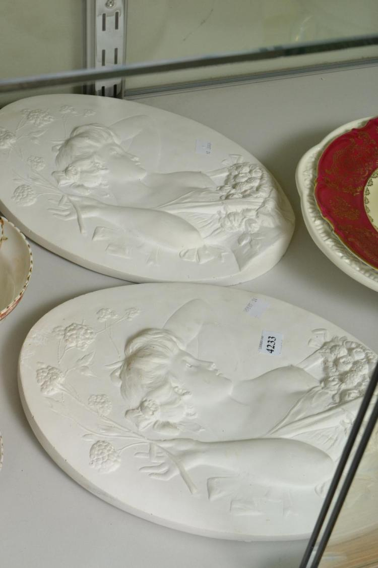 A PAIR OF CHALKWARE PLAQUES