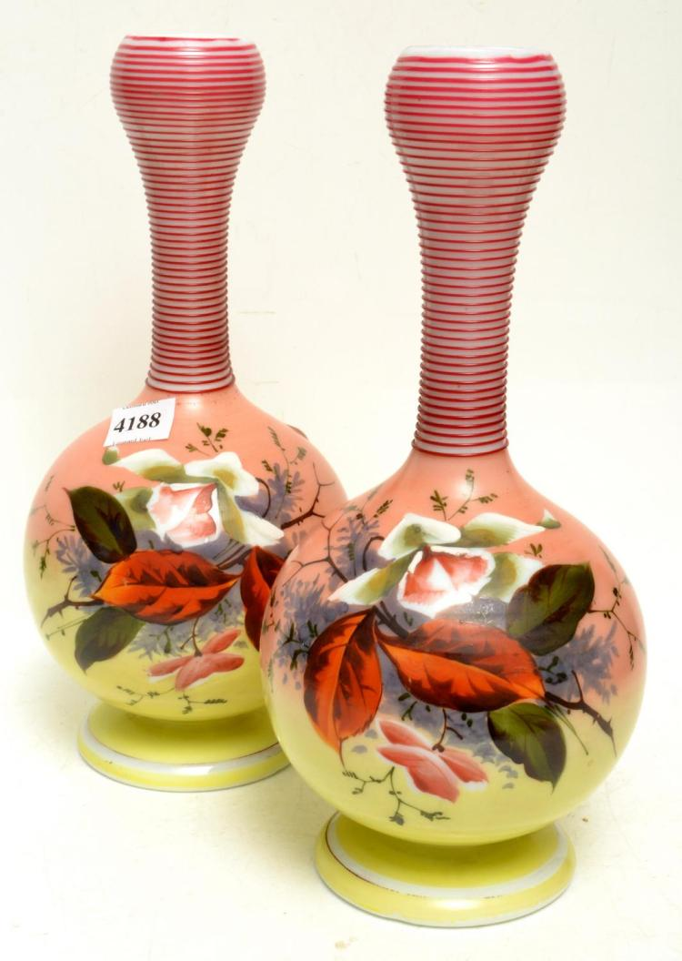 A PAIR OF VICTORIAN MILK GLASS VASES, WITH HANDPAINTED SCENES AND TURNED GLASS NECKS