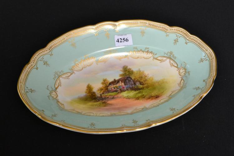 A 1940S ROYAL WORCESTER LANDSCAPE OVAL PAINTED CABINET DISH BY RAYMOND RUSHTON, SIGNED 27 CM DIAMETER