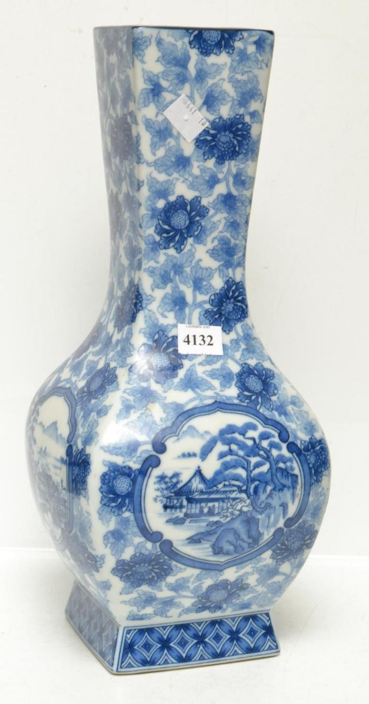 A LARGE JAPANESE BLUE AND WHITE PORCELAIN VASE WITH FOUR LANDSCAPE SCENES, THREE CHARACTER MARKS TO BASE, 36.5 CM HIGH