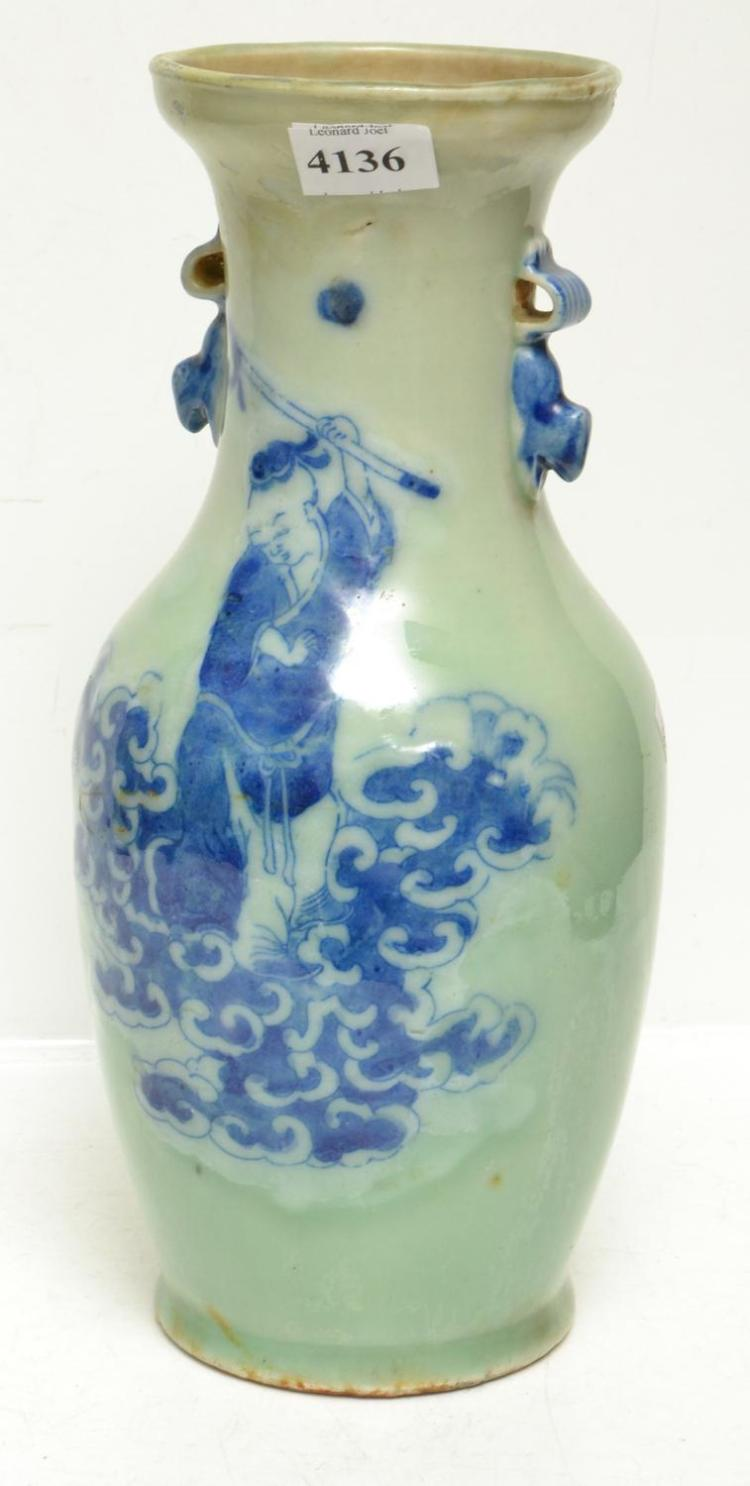 A CHINESE CELADON VASE WITH ELDER MOTIFS