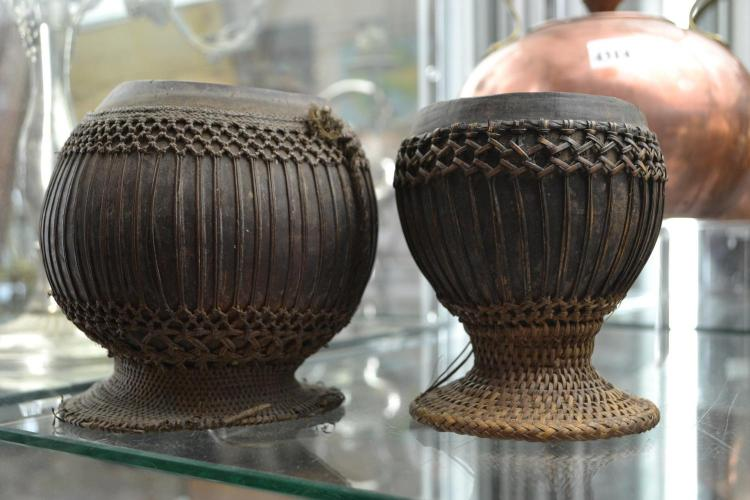 TWO SULAWESI OCEANIC COCONUT HUSKS WITH WOVEN DETAILING, INDONESIA