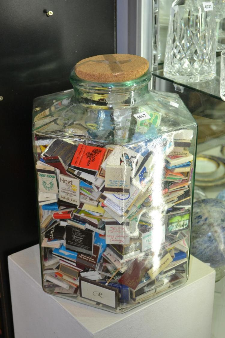 A LARGE PRESSED JAR LIDDED GLASS FULL OF MATCH BOXES, MAINLY FROM THE 50'S AND 40'S