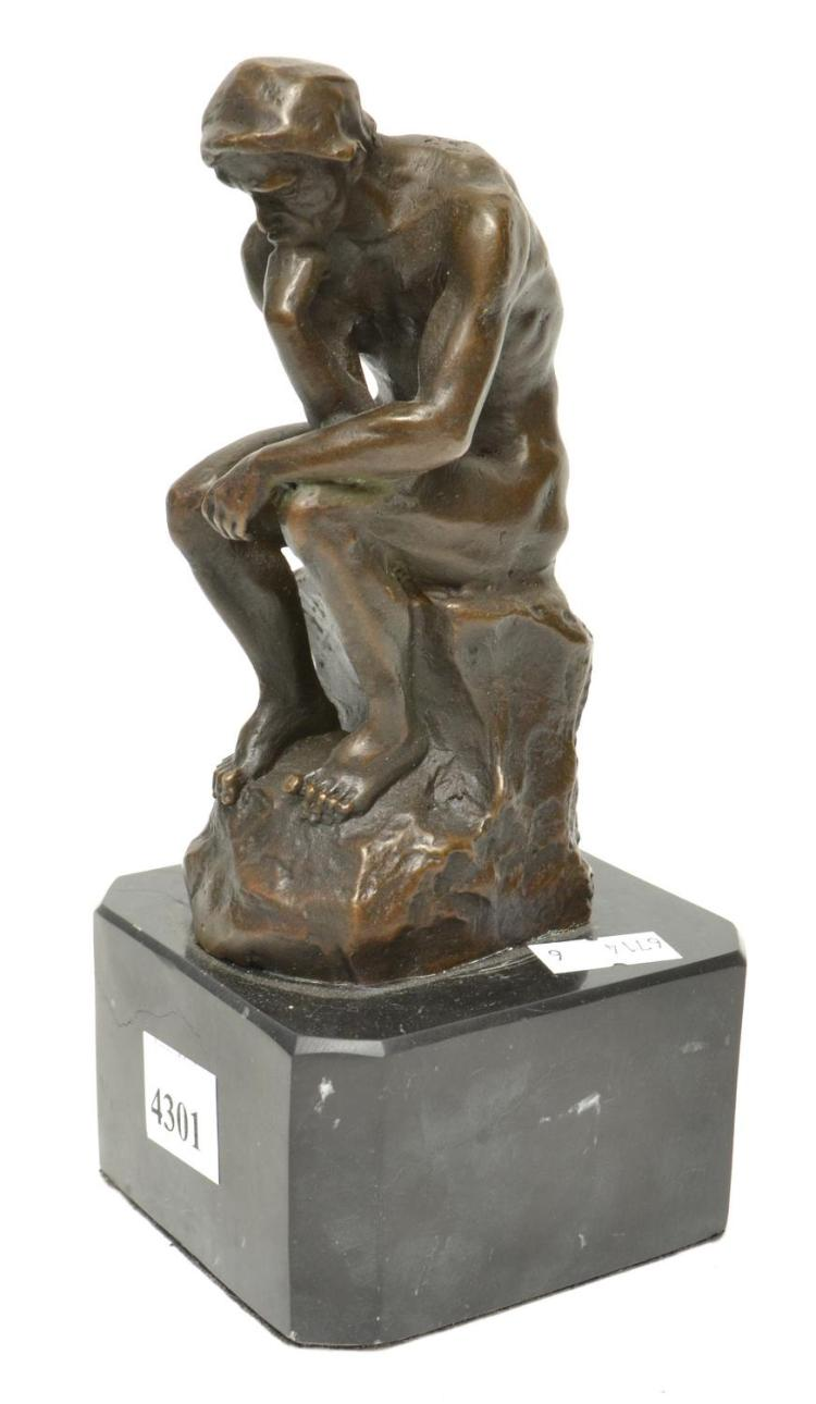 A BRONZE OF 'THE THINKER' ON A MARBLE BASE, AFTER RODIN