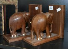 A PAIR OF ELEPHANT BOOK ENDS (FAULTS)