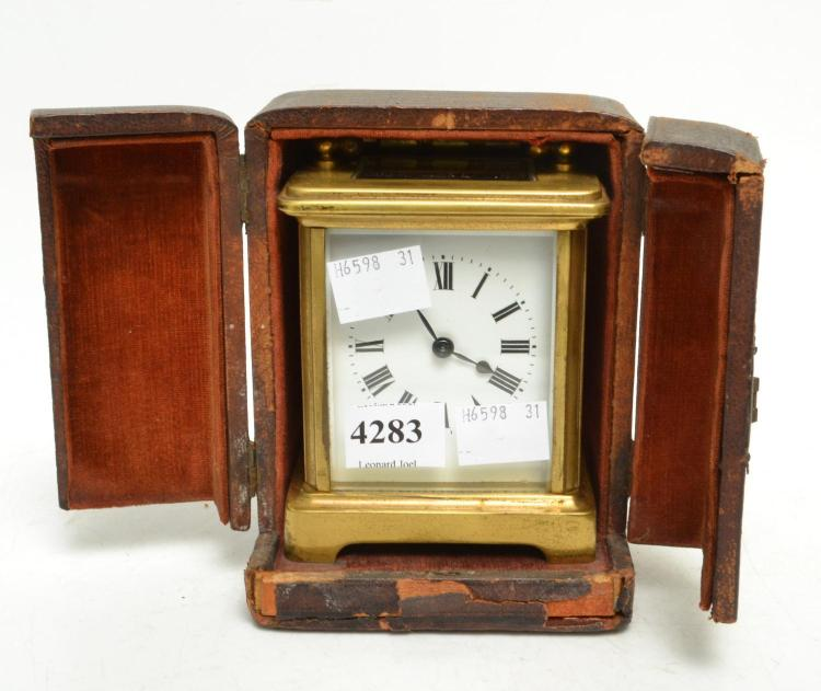 A 19TH CENUTRY FRENCH BRASSS CARRIAGE CLOCK IN LEATHER CASE WHITE ENAMEL FACE- WORKING