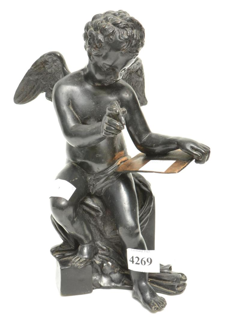 A BRONZE FIGURE OF A CHEERUB