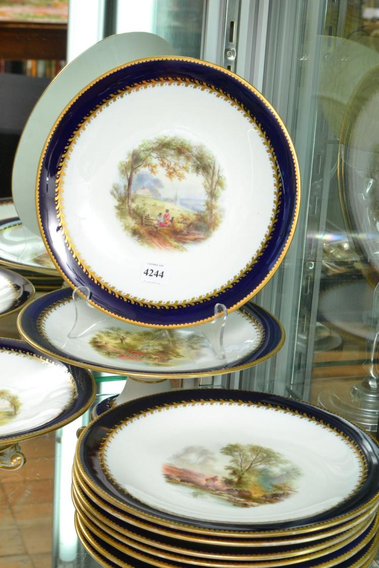 A 19TH CENTURY FRENCH BONE CHINA DESSERT SET FOR 16, ALL DIFFERENT HAND PAINTED SCENES, COBALT BLUE AND GILT BORDERS