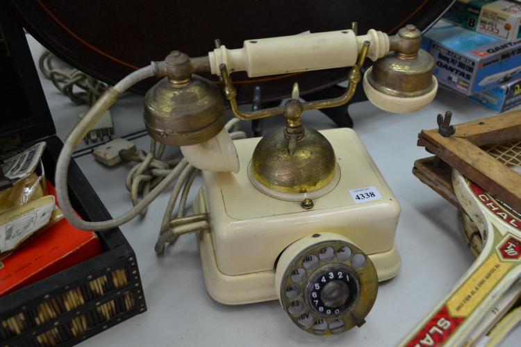 AN EARLY 20TH CENTURY BAKELITE ROTARY PHONE