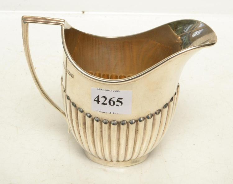 A STERLING SILVER CREAMER