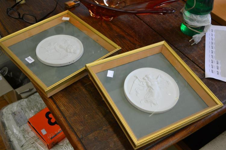 A PAIR OF FRAMED CIRCULAR BISQUE PLAQUES (ONE LOOSE)