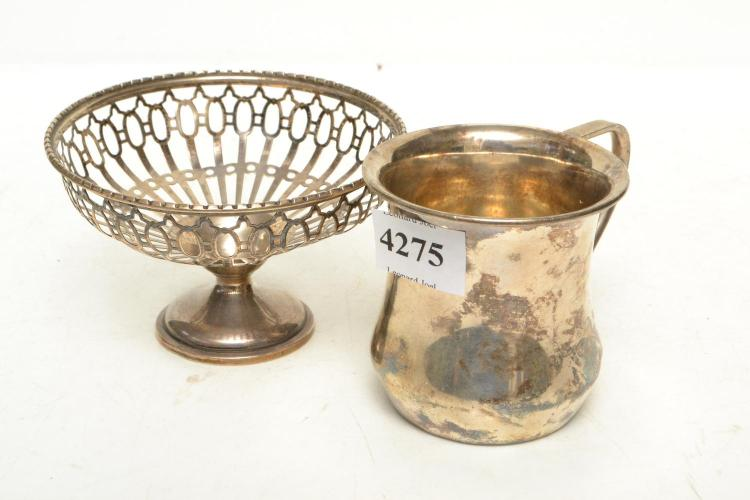 A STERLIONG SILVER CHRISTENING MUG AND PIERCED BON BON BASKET