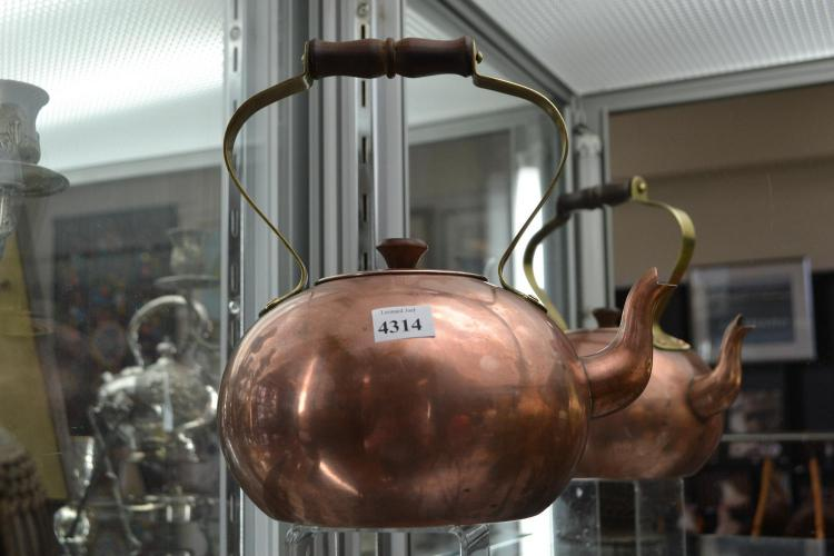 A COPPER AND BRASS TEA POT
