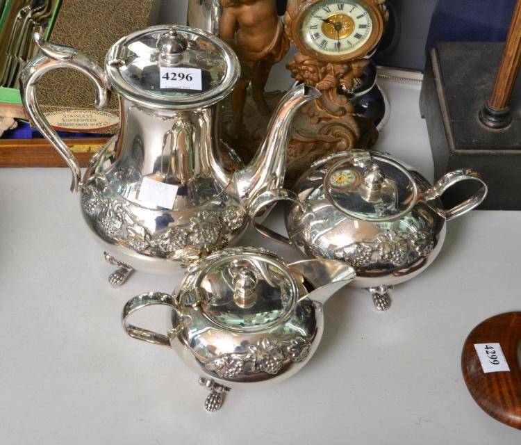 A THREE PIECE EP TEA SET AND TWO CANDLE STICKS