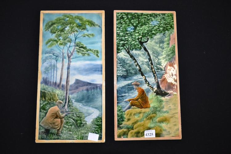 A PAIR OF GLAZED CERAMIC TILES WITH COUNTRY SCENES