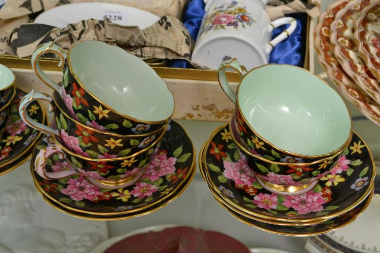 A COLLECTION OF PARAGON DEMITASSE CUPS AND SAUCERS