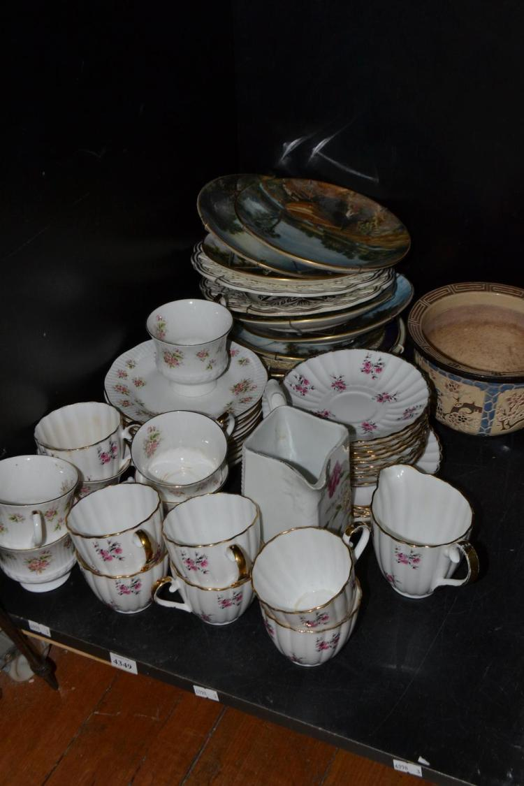 A PART SHELF OF PORCELAIN INCLUDING FLORALWARE AND COLLECTORS PLATES