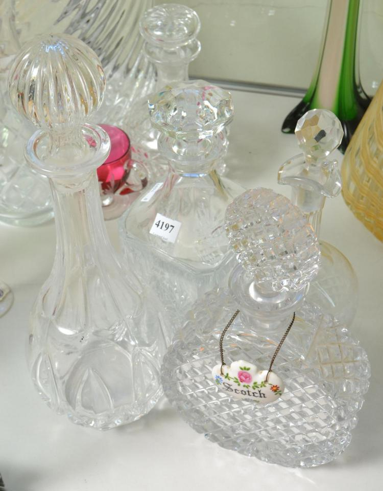 FOUR DECANTERS, INCLUDING CRYSTAL, PRESSED GLASS AND ETCHED