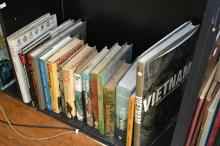A SHELF OF MILITARY REFERENCE, MAINLY RELATED TO THE VIETNAM WAR INCLUDING THE WOMAN IN VIETNAM AND THE BATTLE OF DIENBIENPHU AND TH...