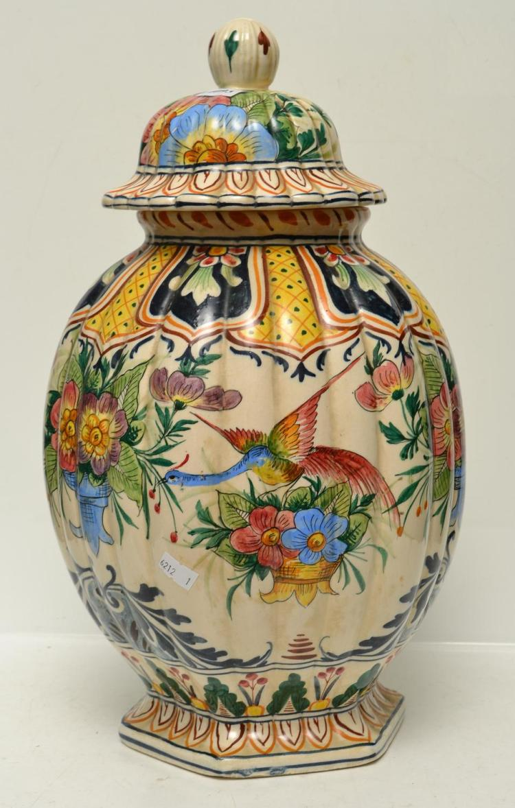 A CONTINENTAL VASE WITH LID
