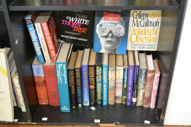 A SHELF OF HARDBACK AUSTRALIAN FICTION INCLUDING TOM KENEALLY