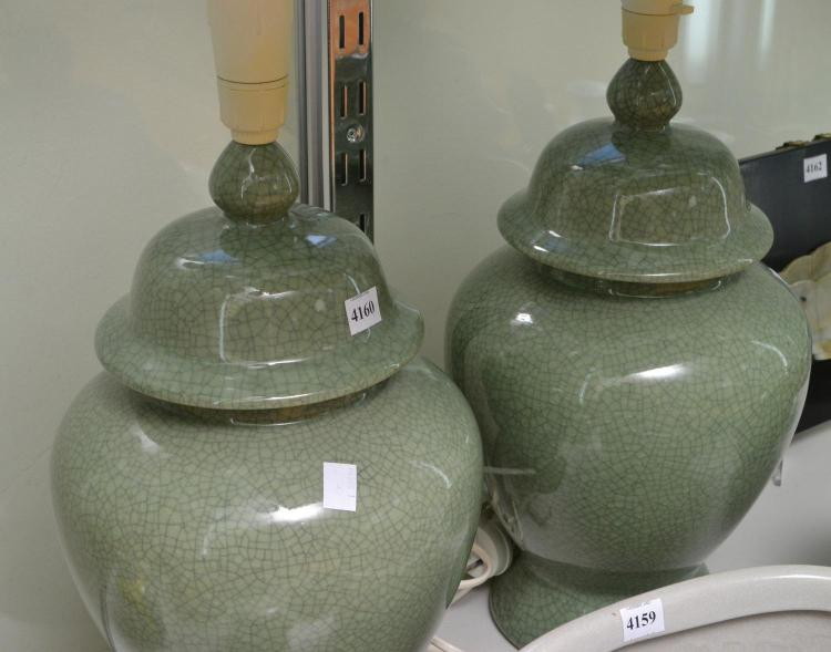 A PAIR OF CELEDON GLASS LAMP BASES (IN WORKING ORDER)
