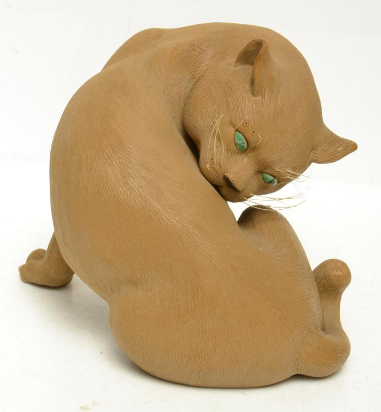 A FOSHUN SHIWAN FIGURE OF A CAT
