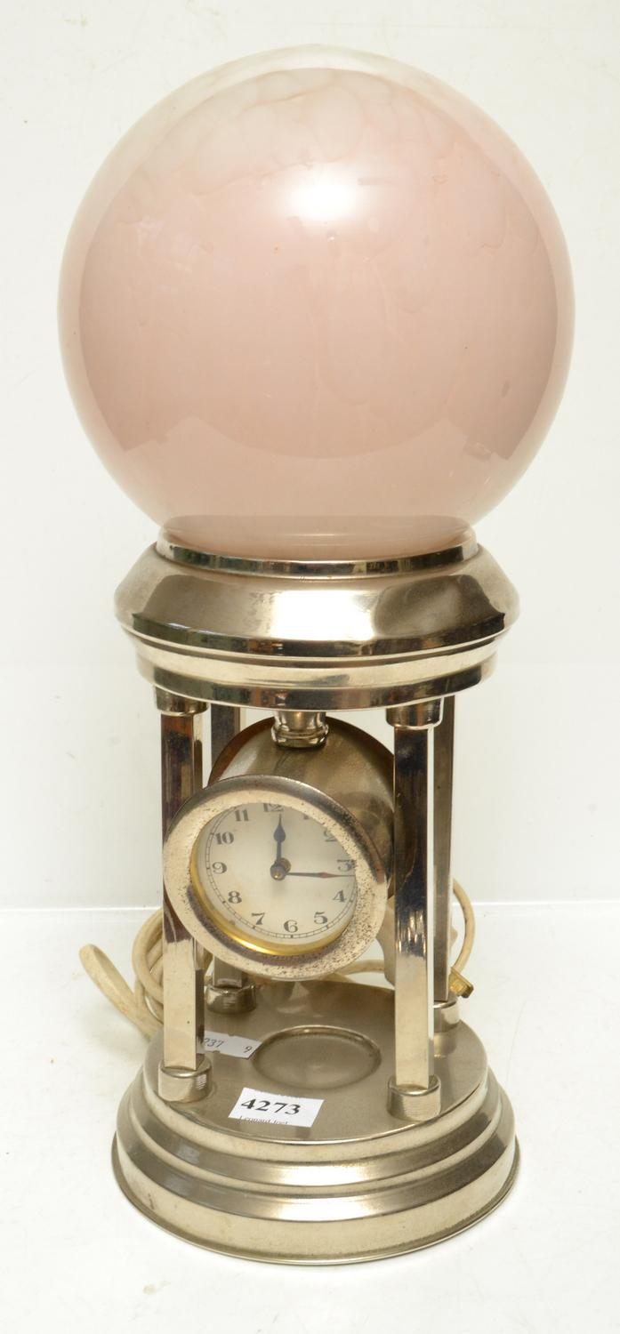 AN ART DECO CHROME CLOCK AND LAMP WITH GLASS SHADE