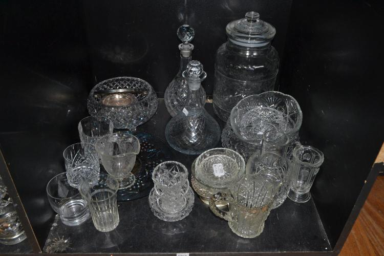 A SHELF OF CRYSTAL AND GLASS INCLUDING DECANTORS