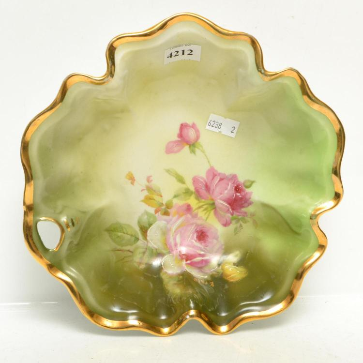 A GERMAN HAND PAINTED PLATE