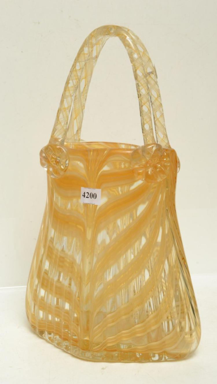A MURANO BASKET IN GOLD TONES