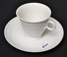 A SET OF FOUR ROYAL COPENHAGEN TEACUPS AND SAUCERS WITH BISQUE BORDERS